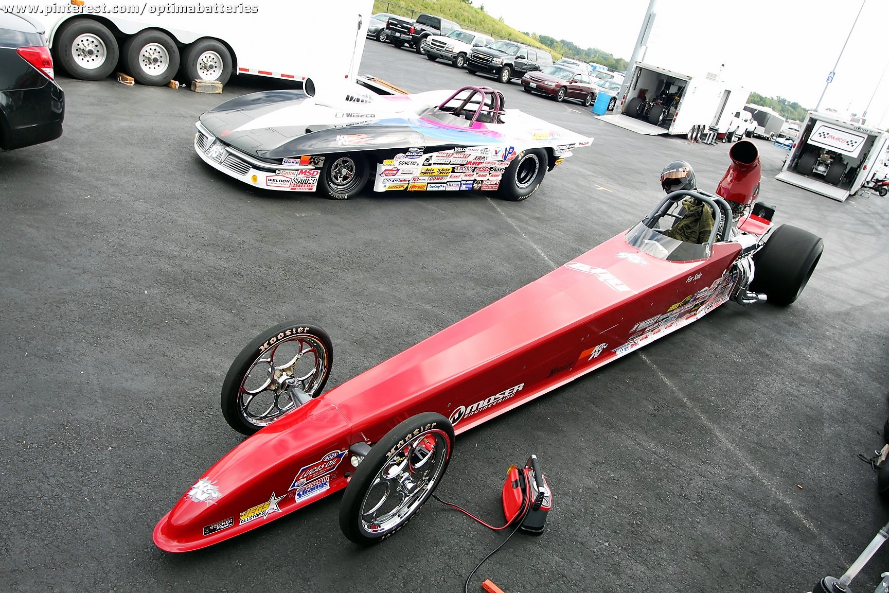 An NHRA dragster has its OPTIMA battery recharged